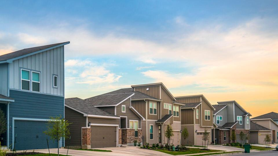 New real estate suburb in Austin, Texas, USA - evening afternoon sunset bright sun on the yards and facades of new homes in the Central Texas area.