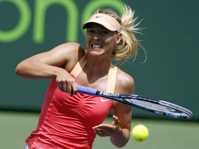 Maria Sharapova of Russia, returns the ball to Agnieszka Radwanska of Poland, during the women's singles final at the Sony Ericsson tennis tournament, Saturday, March 31, 2012, in Key Biscayne, Fla. (AP Photo/Lynne Sladky)