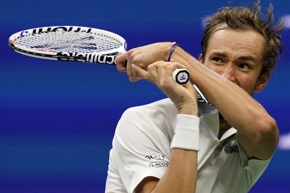 Daniil Medvedev, of Russia, returns to Daniel Evans, of the United Kingdom, during the fourth round of the US Open tennis championships, Sunday, Sept. 5, 2021, in New York. (AP Photo/Seth Wenig)