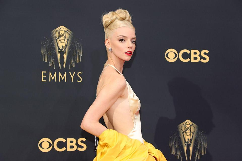 <p>In a breathtaking beauty look, Anya Taylor-Joy nodded to The Queen's Gambit with a crown-like up-do by hairstylist Gregory Russell, and oozed old Hollywood glamour with a true red lip, courtesy of make-up artist Georgie Eisdell using Dior beauty.</p>