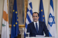 Cypriot Foreign Minister Nikos Christodoulides speaks during a join news conference with his Greek counterpart Nikos Dendias,and Israel's Foreign Minister Gabi Ashkenazi, after a meeting between the foreign Ministers of Greece , Israel and Cyprus in Athens, on Tuesday, Oct. 27, 2020. (AP Photo/Petros Giannakouris)