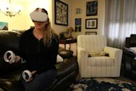 Amy Erdt, who manages a virtual reality Facebook group, sits in her living room in Oregon and travels to foreign cities virtually using her Oculus headset
