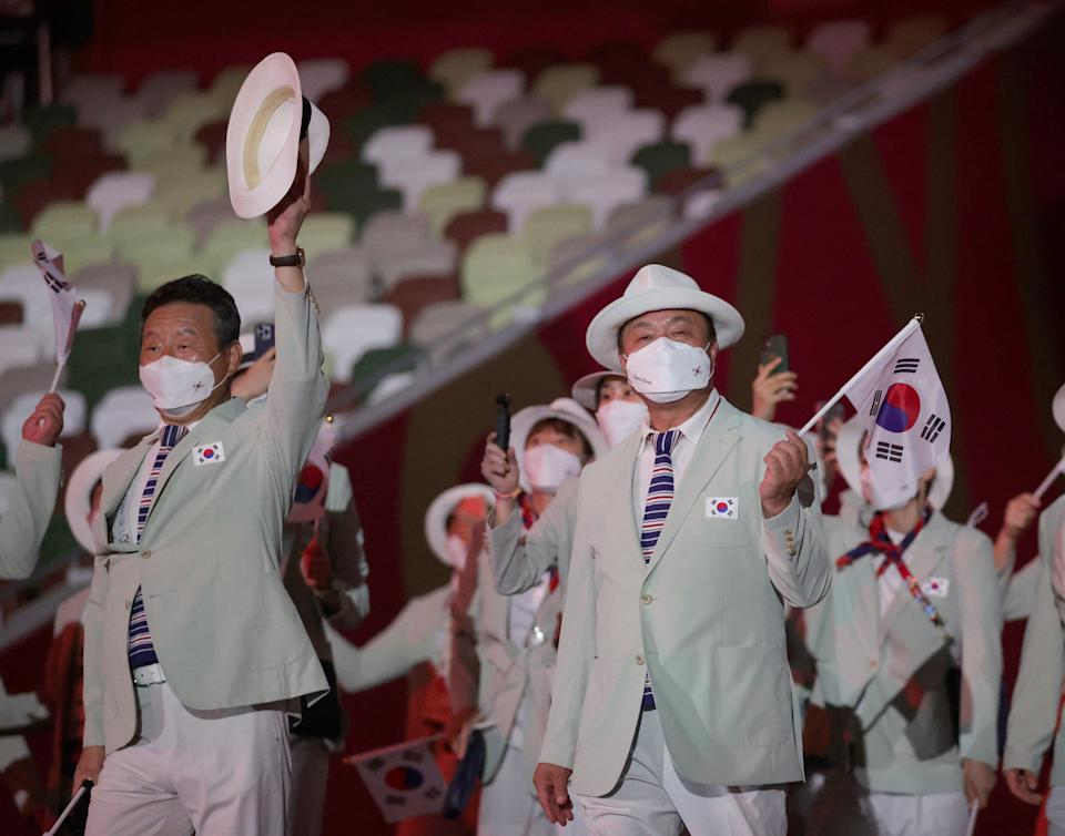 <p>TOKYO, JAPAN - JULY 23: Flag bearers Yeon Koung Kim and Sunwoo Hwang of South Korea lead their team out during the Opening Ceremony of the Tokyo 2020 Olympic Games at Olympic Stadium on July 23, 2021 in Tokyo, Japan. (Photo by Hannah McKay - Pool/Getty Images)</p>