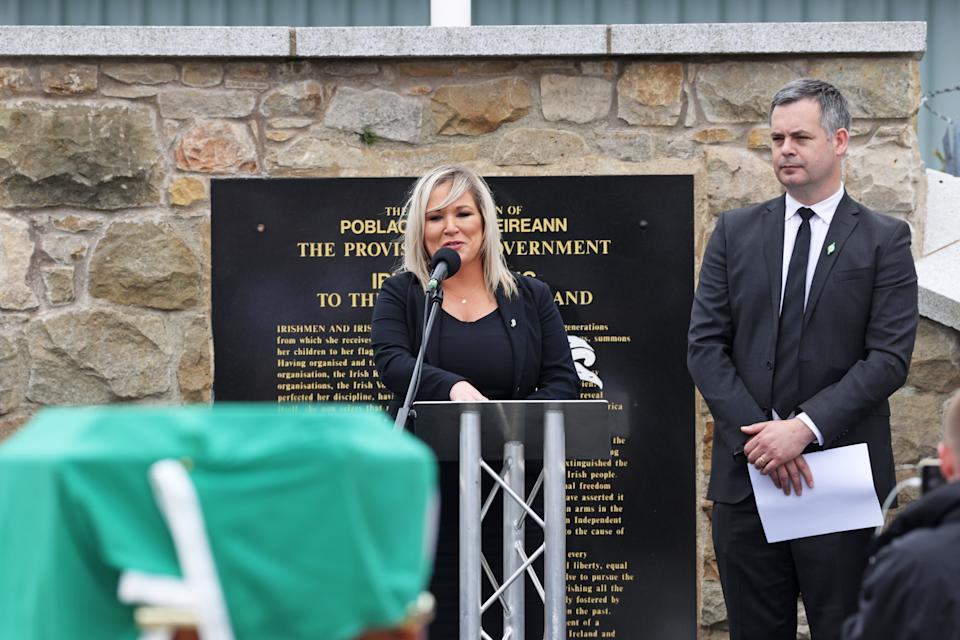 Deputy First Minister Michelle O'Neill speaks alongside Sinn Fein TD Pearse Doherty during the funeral of senior Irish Republican and former leading IRA figure Bobby Storey at Milltown Cemetery in west Belfast. (Photo by Liam McBurney/PA Images via Getty Images)