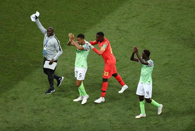 Soccer Football - World Cup - Group D - Nigeria vs Iceland - Volgograd Arena, Volgograd, Russia - June 22, 2018 Nigeria's William Troost-Ekong, Francis Uzoho and Wilfred Ndidi celebrate victory after the match REUTERS/Sergio Perez