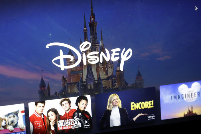 FILE - In this Wednesday, Nov. 13, 2019, file photo, a Disney logo forms part of a menu for the Disney Plus movie and entertainment streaming service on a computer screen in Walpole, Mass. Streaming services ranging from Netflix to Disney+ want us to stop sharing passwords. That's the new edict from the giants of streaming media, who hope to discourage the common practice of sharing account passwords without alienating their subscribers, who've grown accustomed to the hack. (AP Photo/Steven Senne, File)
