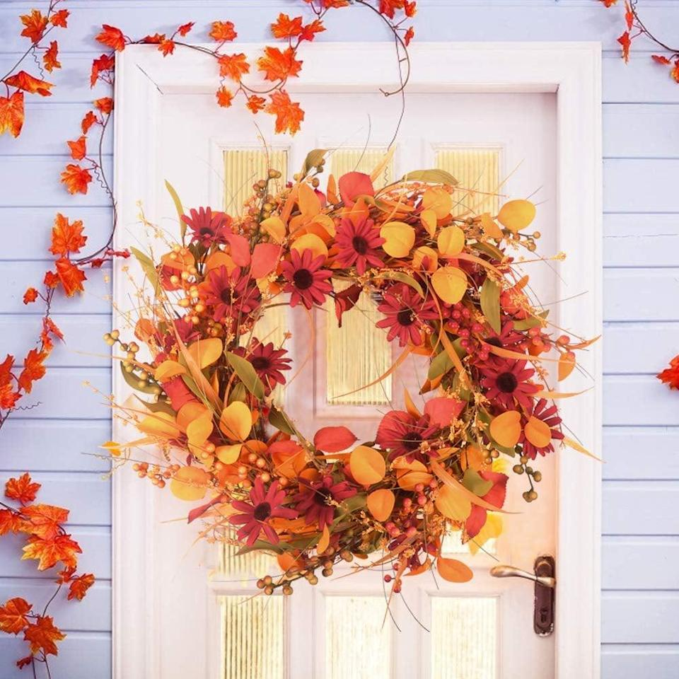 """<p>Get ready for fall vibes with this <span>AOLIGE 24"""" Front Door Wreath</span> ($30).</p>"""