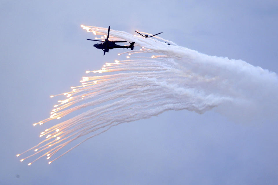 Photo shows Taiwan's AH-64E Apache attack helicopter launching flares during military exercises.