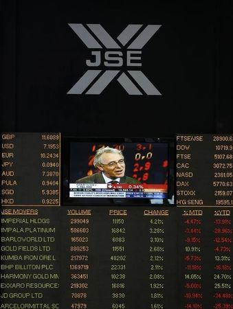 An electronic board displays movements in major indices at the Johannesburg Stock Exchange in Sandton