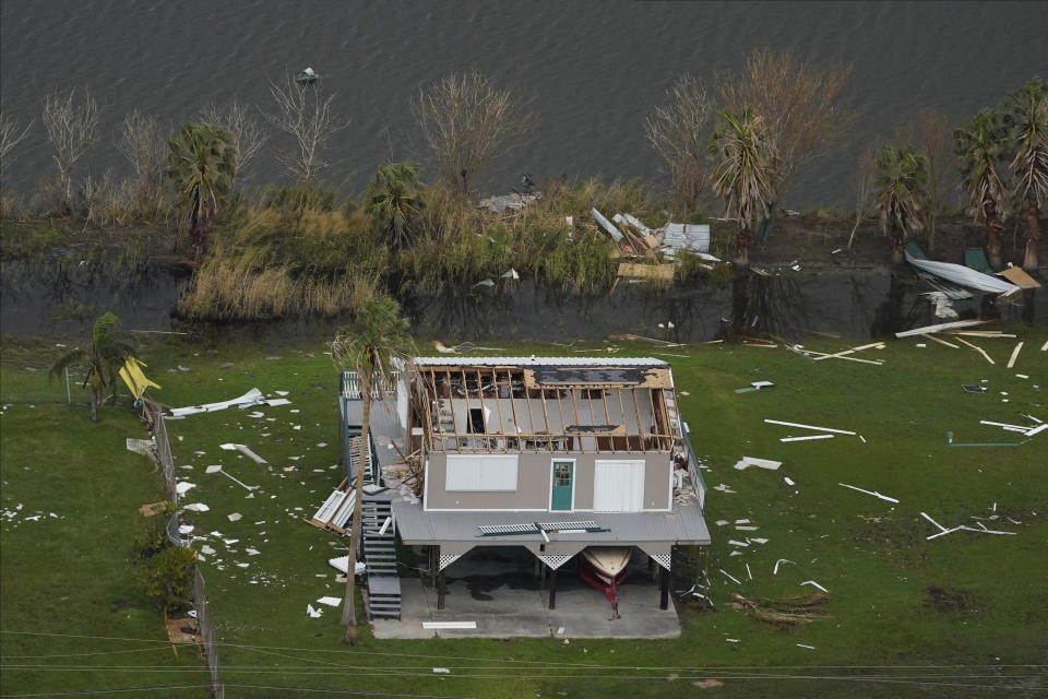 In this aerial photo, the remains of a damaged home are seen in the aftermath of Hurricane Ida, Monday, Sept. 6, 2021, in Grand Isle, La. (AP Photo/Matt Slocum)