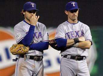 Ian Kinsler (left) and Michael Young, now veterans of two World Series defeats, stand on the field during the Rangers' 6-2 loss in Game 7