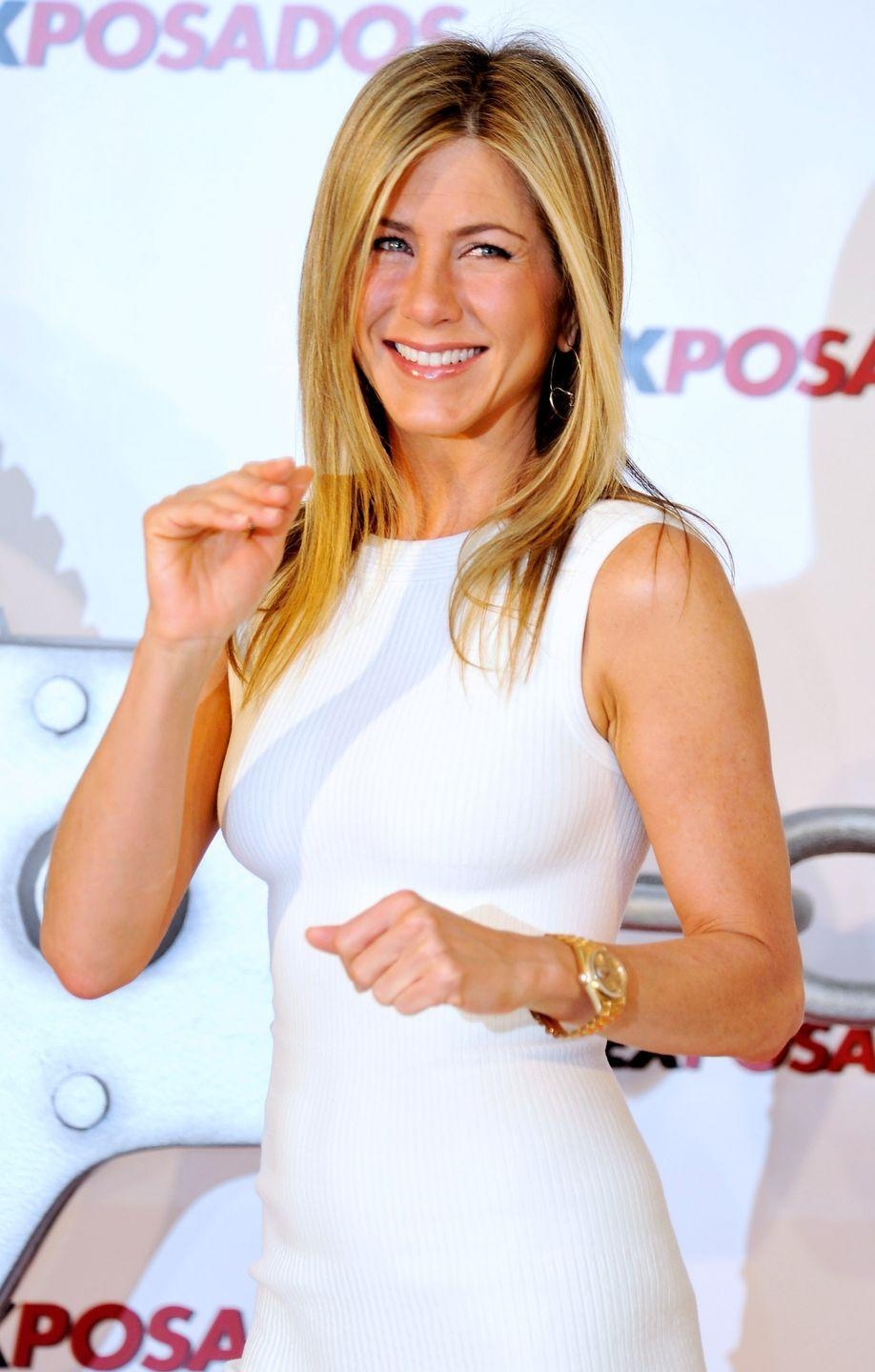 """<p>Jen can really rock a sleeveless dress. Maybe that's because of her toned arms, which comes from <a href=""""https://people.com/food/how-to-get-jennifer-anistons-amazingly-toned-arms/"""" rel=""""nofollow noopener"""" target=""""_blank"""" data-ylk=""""slk:varying her workouts"""" class=""""link rapid-noclick-resp"""">varying her workouts</a> that include boxing and yoga. If you want to work on your arms, try some of these <a href=""""https://www.womenshealthmag.com/fitness/g28615817/bicep-and-triceps-workout/"""" rel=""""nofollow noopener"""" target=""""_blank"""" data-ylk=""""slk:17 bicep and tricep workouts"""" class=""""link rapid-noclick-resp"""">17 bicep and tricep workouts</a>. </p>"""