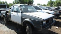 """<p>The pickup version of the Mk1 <a class=""""link rapid-noclick-resp"""" href=""""https://www.autoblog.com/volkswagen/rabbit/"""" data-ylk=""""slk:Volkswagen Rabbit"""">Volkswagen Rabbit</a> (known outside of North America as the <a href=""""https://en.wikipedia.org/wiki/Volkswagen_Caddy#First_generation_(Typ_14;_1979%E2%80%931996)"""" rel=""""nofollow noopener"""" target=""""_blank"""" data-ylk=""""slk:Volkswagen Golf Caddy"""" class=""""link rapid-noclick-resp"""">Volkswagen Golf Caddy</a>) rolled off the assembly lines of the Westmoreland, Pennsylvania <a class=""""link rapid-noclick-resp"""" href=""""https://www.autoblog.com/volkswagen/"""" data-ylk=""""slk:VW"""">VW</a> plant from the 1979 through 1984 model years, and even had some front-wheel-drive econo-truck competition from the <a href=""""https://www.autoblog.com/2016/06/20/junkyard-1983-dodge-rampage/"""" data-ylk=""""slk:Dodge Rampage"""" class=""""link rapid-noclick-resp"""">Dodge Rampage</a>/<a href=""""https://24hoursoflemons.com/blog/team-haulin-ass-1983-plymouth-scamp-24-hours-of-lemons-race-truck/"""" rel=""""nofollow noopener"""" target=""""_blank"""" data-ylk=""""slk:Plymouth Scamp"""" class=""""link rapid-noclick-resp"""">Plymouth Scamp</a>. Mk1 <a class=""""link rapid-noclick-resp"""" href=""""https://www.autoblog.com/volkswagen/rabbit/"""" data-ylk=""""slk:Rabbits"""">Rabbits</a> of any sort have become <a href=""""http://www.murileemartin.com/Junkyard/JunkyardGallery-Volkswagen.html"""" rel=""""nofollow noopener"""" target=""""_blank"""" data-ylk=""""slk:junkyard rarities"""" class=""""link rapid-noclick-resp"""">junkyard rarities</a> for me in recent years, especially the <a href=""""http://autoweek.com/article/junkyard-treasures/junkyard-treasure-1981-volkswagen-rabbit-diesel"""" rel=""""nofollow noopener"""" target=""""_blank"""" data-ylk=""""slk:diesel cars"""" class=""""link rapid-noclick-resp"""">diesel cars</a>, so this mightily-picked-over '81 was worth photographing despite the giant hunks of its flesh torn out by ravenous wrecking-yard vultures. <a href=""""https://www.autoblog.com/2019/09/30/junkyard-gem-1981-volkswagen-rabbit-diesel-pickup/"""" data-ylk=""""slk:Read more"""" cla"""