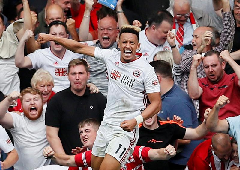 "Soccer Football - Premier League - Chelsea v Sheffield United - Stamford Bridge, London, Britain - August 31, 2019 Sheffield United's Callum Robinson celebrates scoring their first goal REUTERS/David Klein EDITORIAL USE ONLY. No use with unauthorized audio, video, data, fixture lists, club/league logos or ""live"" services. Online in-match use limited to 75 images, no video emulation. No use in betting, games or single club/league/player publications. Please contact your account representative for further details."