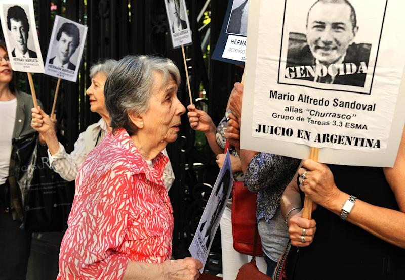 Beatriz Cantarini de Abriata, mother of Hernan Abriata, who disappeared in 1976 in Argentina, protests in front of the French embassy in April 2014