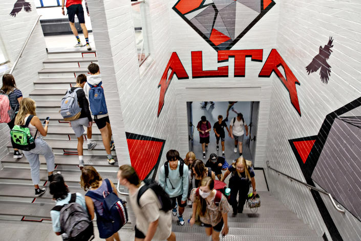 Students walk to class at Alta High School in Sandy, Utah, on Sept. 16, 2021, one of 13 schools in the state that conducted test-to-stay events early this year. (Kim Raff/The New York Times)