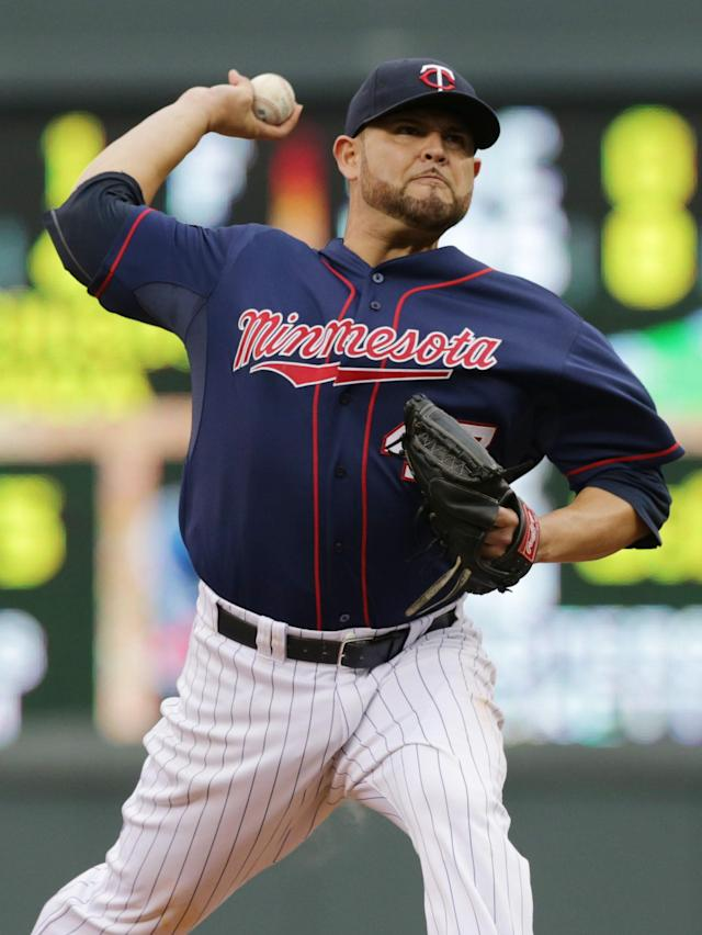 Minnesota Twins pitcher Ricky Nolasco throws against the Kansas City Royals in the first inning of a baseball game, Tuesday, July 1, 2014, in Minneapolis. (AP Photo/Jim Mone)