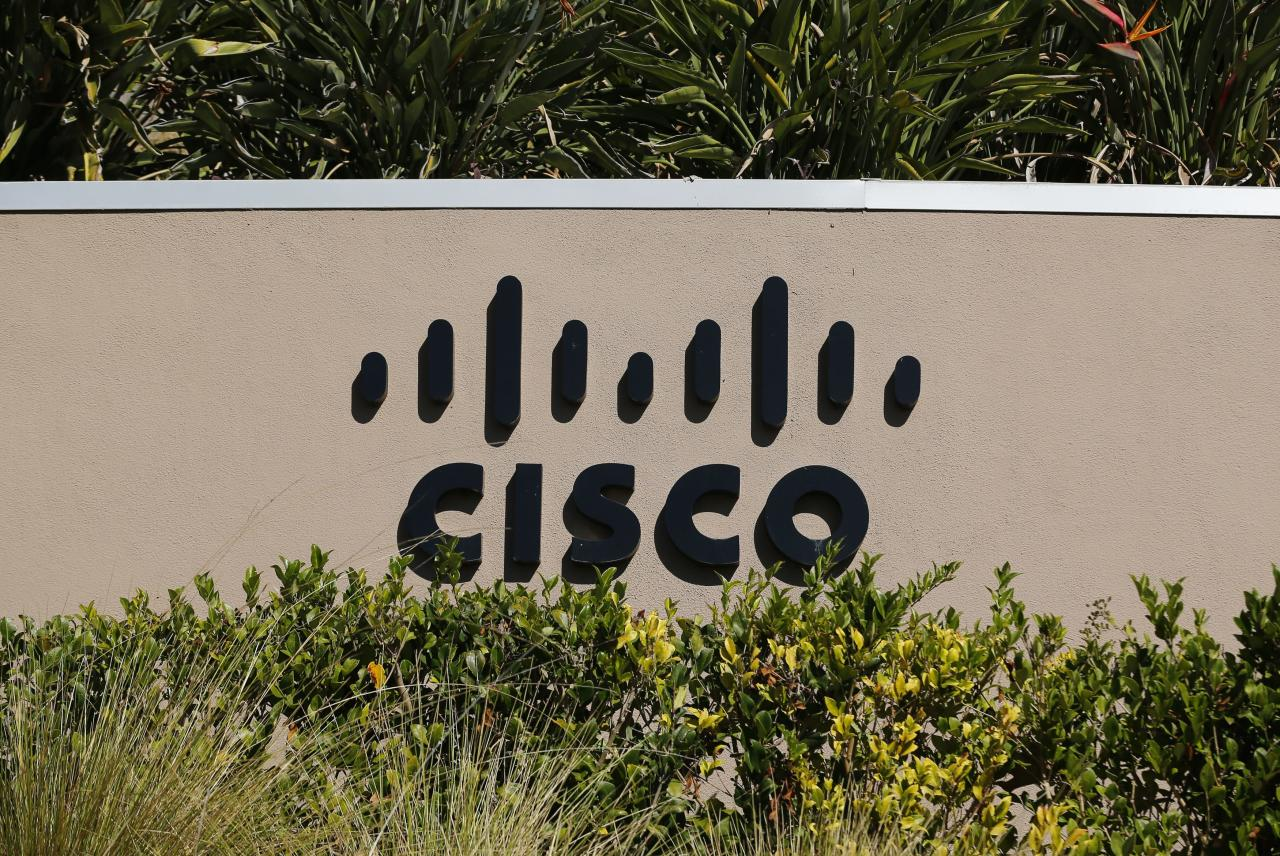 A sign marking a Cisco office is pictured in San Diego, California November 12, 2012. Tech investors hoping for good news may have to look further than Cisco Systems Inc's quarterly report as analysts expect Chief Executive John Chambers to be pessimistic in his forecast for the coming year.     REUTERS/Mike Blake   (UNITED STATES - Tags: BUSINESS LOGO)