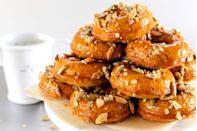 """<p>As if these pumpkin donuts weren't already wonderful enough, the accompanying bourbon caramel glaze will be enough to send you over the edge.</p><p><strong><a href=""""https://thepioneerwoman.com/food-and-friends/pumpkin-spiced-donuts-with-bourbon-caramel-glaze/"""" rel=""""nofollow noopener"""" target=""""_blank"""" data-ylk=""""slk:Get the recipe"""" class=""""link rapid-noclick-resp"""">Get the recipe</a>.</strong></p><p><strong><a class=""""link rapid-noclick-resp"""" href=""""https://go.redirectingat.com?id=74968X1596630&url=https%3A%2F%2Fwww.walmart.com%2Fip%2FThe-Pioneer-Woman-Vintage-Floral-14-5-Inch-Serving-Platter%2F147105294&sref=https%3A%2F%2Fwww.thepioneerwoman.com%2Ffood-cooking%2Fmeals-menus%2Fg32110899%2Fbest-halloween-desserts%2F"""" rel=""""nofollow noopener"""" target=""""_blank"""" data-ylk=""""slk:SHOP SERVING PLATTERS"""">SHOP SERVING PLATTERS </a><br></strong></p>"""