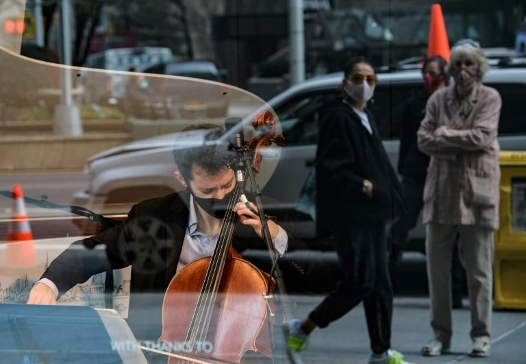 Musicians Michael Katz, on cello, and pianist Spencer Myer perform at a storefront series highlighting musicians after a devastating year for entertainment