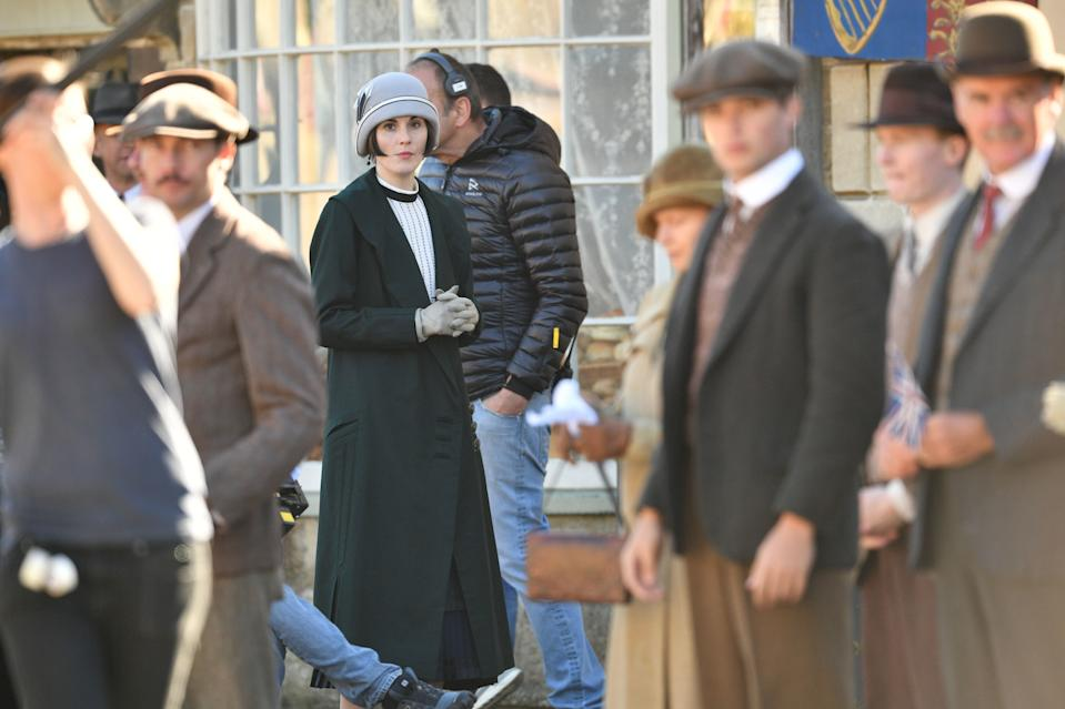 Michelle Dockery and other cast members on the Downton Abbey film set in Lacock, Wiltshire. (Photo by Ben Birchall/PA Images via Getty Images)