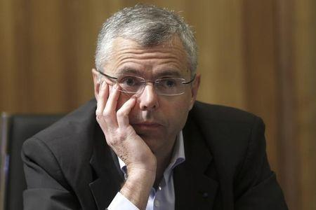 Michel Combes, Telecom equipment maker Alcatel-Lucent Chief Executive Officer, attends an interview with Reuters in Paris