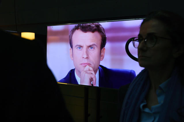 "<span class=""s1"">French candidate Emmanuel Macron is shown on a television screen backstage before a debate in May. (Photo: Eric Feferberg/AFP/Getty Images)</span>"
