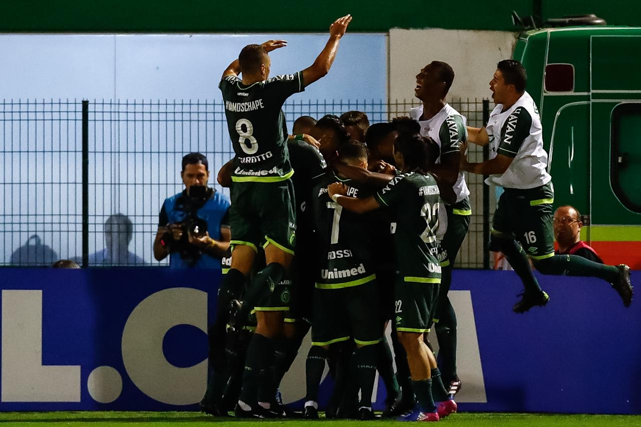 <p>Chapecoense celebrate their winning goal </p>
