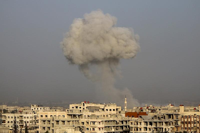 Smoke rises after airstrikes on eastern Ghouta's town of Kafr Batna in Syria on Friday.