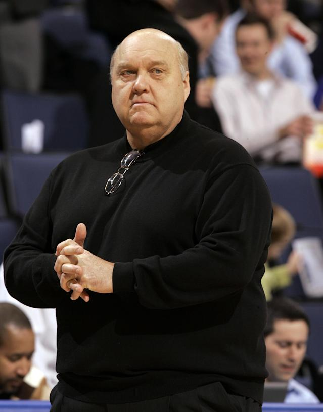 FILE - In this Jan. 14, 2009, file photo, Saint Louis coach Rick Majerus stands on the sidelines during the first half of an NCAA college basketball game against Massachusetts in St. Louis. Majerus, the jovial college basketball coach who led Utah to the 1998 NCAA final and had only one losing season in 25 years with four schools, died Saturday, Dec. 1, 2012. He was 64. (AP Photo/Jeff Roberson, File)
