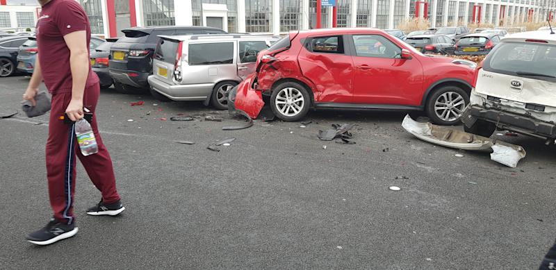 "PIC BY MERCURY PRESS (PICTURED the trail of destruction left by a Range Rover after it drove into 4 parked cars at a gym in Garston, Liverpool) Must've been leg day! Gymgoers were shocked after a bungling female driver in a Range Rover destroyed four parked cars – before driving off. These dramatic scenes show the aftermath at 24/7 Fitness in Garston, Liverpool, this morning [THURS] after four cars were totalled by the clumsy motorist, believed to be in her early to mid-twenties. An eyewitness, who asked not to be named, spotted the carnage after finishing her workout. The woman said: ""I walked out of the gym and heard a car alarm going off. SEE MERCURY COPY"