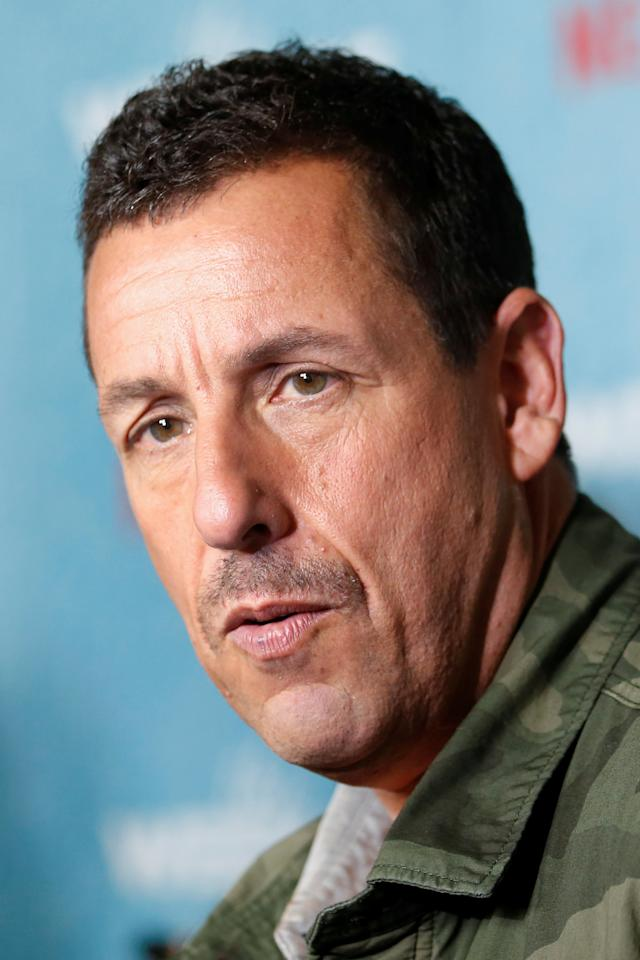 "Actor Adam Sandler speaks to the media on the red carpet during the premiere of ""The Week Of "" in Manhattan, New York, U.S., April 23, 2018. REUTERS/Shannon Stapleton"