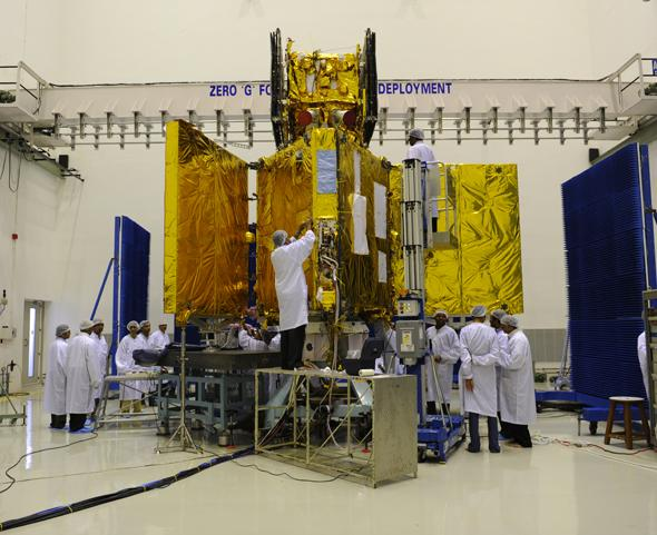 The team at work. N. Valramathi, project director, is the first Indian woman to launch an earth orbiting satellite.