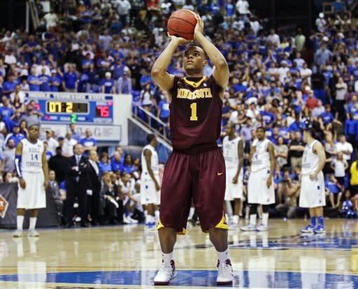 Minnesota guard Andre Hollins (1) shoots a free throw after a technical foul was called against Middle Tennessee in the closing seconds of a quarterfinal NIT college basketball tournament game on Wednesday, March 21, 2012, in Murfreesboro, Tenn. Minnesota won 78-72. (AP Photo/Mark Humphrey)