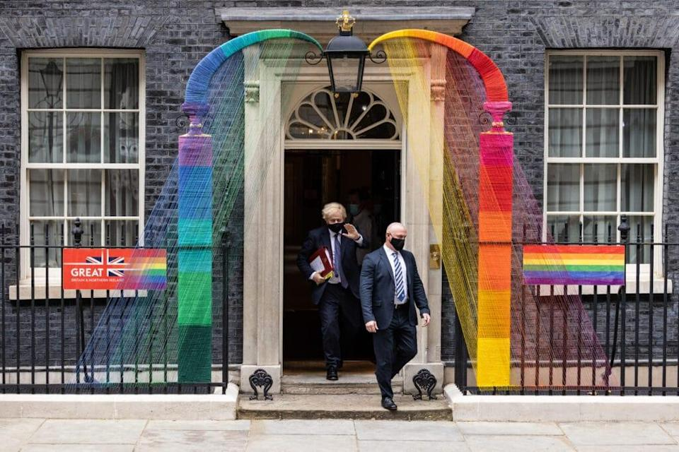 Britain's prime minister Boris Johnson (C) walks beneath the Pride Month installation outside number 10. (Leon Neal/Getty Images)