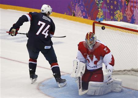 Team USA's Oshie scores on the team's fifth shootout attempt against Russia's goalie Bobrovski during their men's preliminary round ice hockey game at the Sochi 2014 Winter Olympic Games