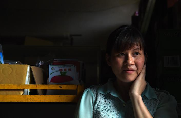 Vietnamese bride Nguyen Thi Hang pictured in the shop where she works in Weijian village, China's Henan province on July 29, 2014 (AFP Photo/Greg Baker)