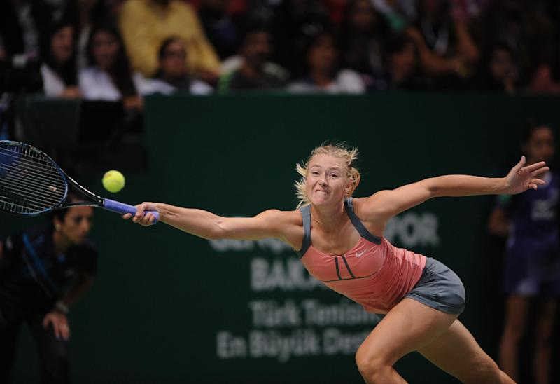Maria Sharapova of Russia returns a shot to Serena Williams of the U. S. during the final tennis match of the WTA Championships in Istanbul, Turkey, Sunday, Oct. 28, 2012. (AP Photo)
