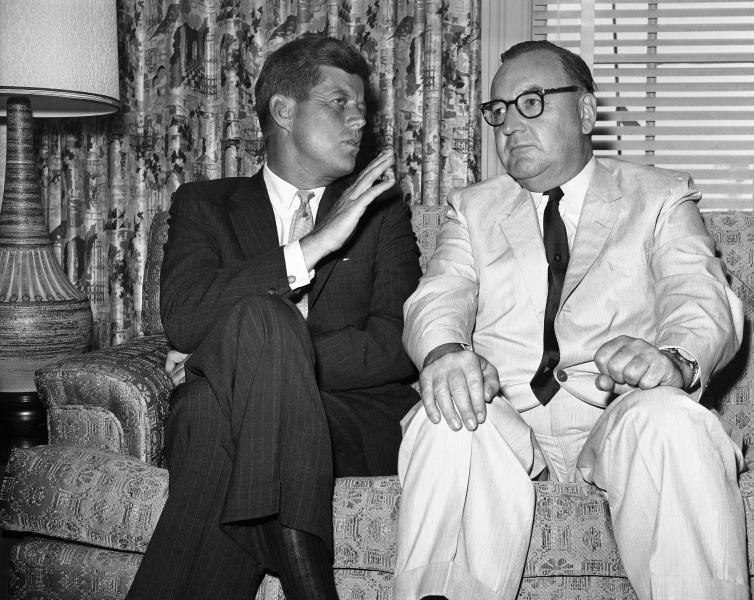 """FILE - In this July 10, 1960, file photo, Sen. John F. Kennedy of Massachusetts gestures during his meeting with California Gov. Edmund G. (Pat) Brown in Los Angeles. Former California Gov. Jerry Brown wants to know who is trying to sell his father's memorabilia related to the assassination of President John F. Kennedy. Private letters and other items that had belonged to Edmund G. """"Pat"""" Brown when he was California governor are being offered by the auction house Sotheby's, which estimates the value at $20,000 to $30,000.   (AP Photo, File)"""