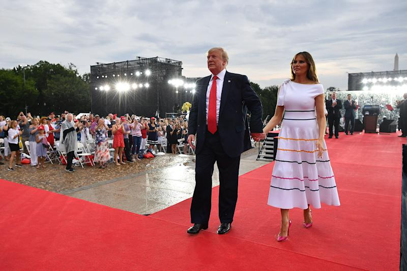 "US President Donald Trump (L) and First Lady Melania Trump leave after attending the ""Salute to America"" Fourth of July event at the Lincoln Memorial in Washington, DC, July 4, 2019. (Photo by MANDEL NGAN / AFP) (Photo credit should read MANDEL NGAN/AFP/Getty Images)"