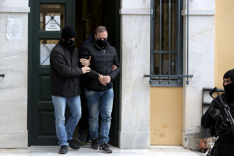 FILE PHOTO: Greek actor and former director of Greece's National Theatre Lignadis is escorted by plain clothes police officers as he leaves the prosecutor's office in Athens