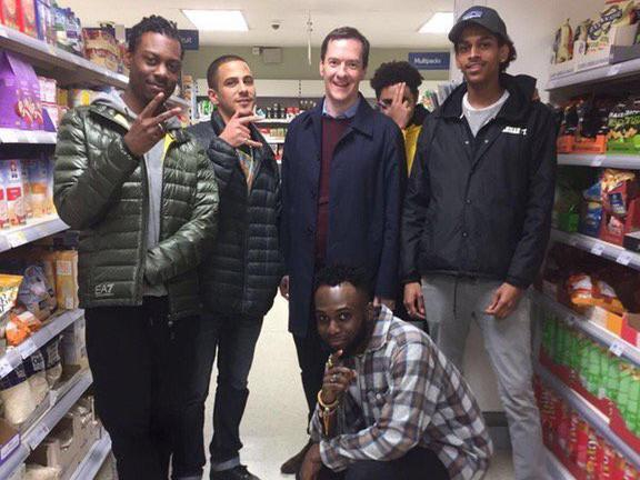 George Osborne poses with a group of youths in a supermarket: Twitter @BenGartside