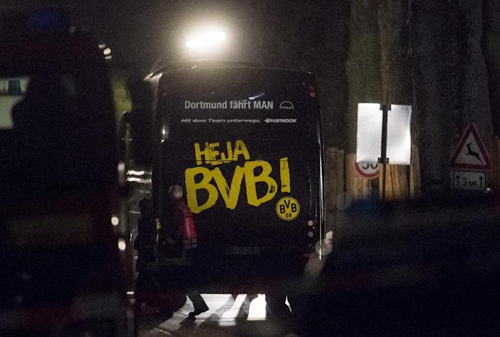 Borussia Dortmund's bus was damaged in a series of three explosions ahead of the team's scheduled Champions League clash against Monaco in Dortmund (AFP Photo/Bernd Thissen)