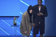 """Justin Bieber, left, and Giveon accept the award for best pop song for """"Peaches"""" at the MTV Video Music Awards at Barclays Center on Sunday, Sept. 12, 2021, in New York. (Photo by Charles Sykes/Invision/AP)"""