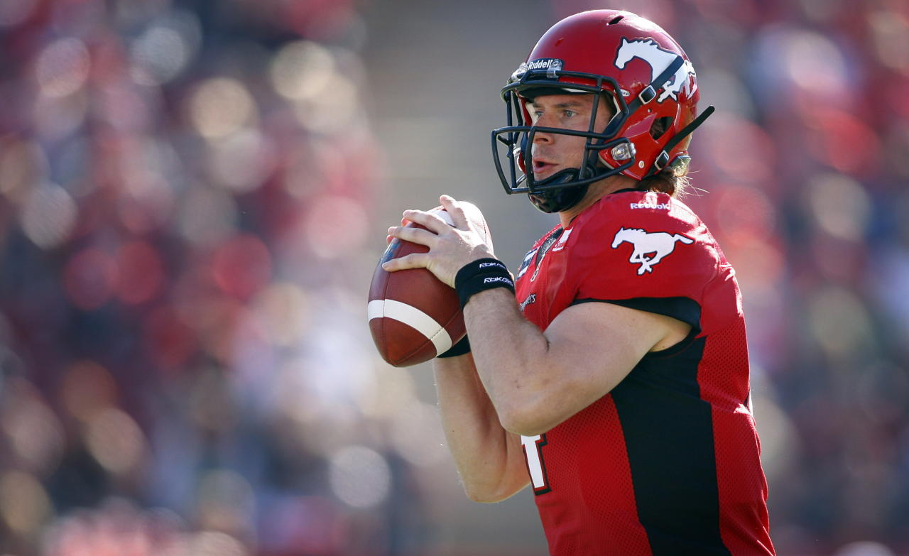 Calgary Stampeders' quarterback Drew Tate looks for a receiver during first half CFL football action against the Montreal Alouettes in Calgary, Alta., Sunday, July 1, 2012. THE CANADIAN PRESS/Jeff McIntosh