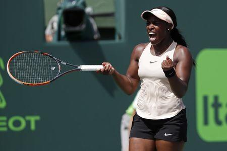 Mar 29, 2018; Key Biscayne, FL, USA; Sloane Stephens of the United States celebrates after match point against Victoria Azarenka of Belarus (not pictured) in a women's singles semi-final of the Miami Open at Tennis Center at Crandon Park.  Mandatory Credit: Geoff Burke-USA TODAY Sports