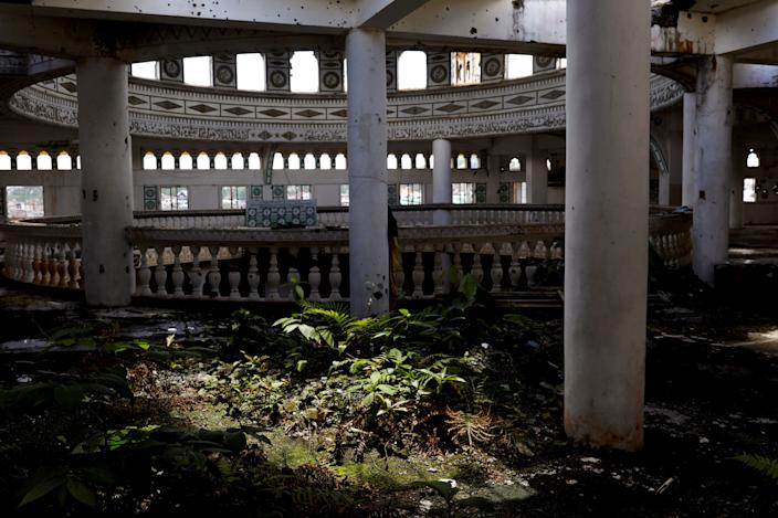 Weeds have grown at the bullet-riddled Grand Mosque in Marawi City, Lanao del Sur province, Philippines. Nature has taken over many structures in the city as it remains abandoned two years after pro-Islamic State militants began their attack on May 23, 2017. (Photo: Eloisa Lopez/Reuters)