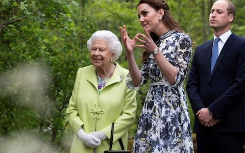 The Queen and Duke and Duchess of Cambridge at the RHS Chelsea Flower Show - Credit: Geoff Pugh/AFP
