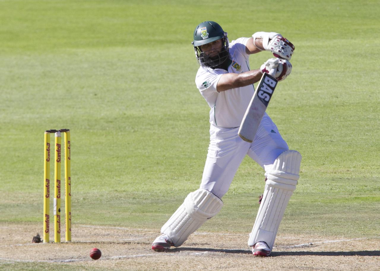 South Africa's Hashim Amla plays a shot during the third day of the second cricket test match against Australia in Port Elizabeth February 22, 2014. REUTERS/Rogan Ward (SOUTH AFRICA - Tags: SPORT CRICKET)
