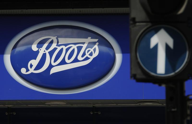 A sign outside a store of pharmacy and cosmetics chain Boots is seen in London